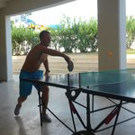 Alex playing table tennis