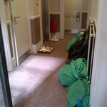Hallway with dirty laundry, trays, trash