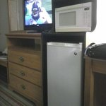 Flat screen TV, Refrigerator and Microwave Oven