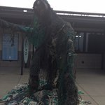 Trash monster made with 450 lbs of trash found inside a whale.