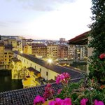 View of Ponte Vecchio at dusk from roof top terrace