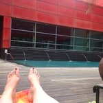 Lounging by the pool while waiting to head to the airport