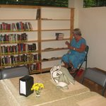 Our new librarian Peggy Stewart setting up new donated books to our community lending library