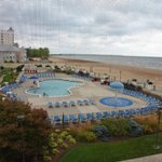 View of the outdoor pool, spa, splash area, boardwalk, & beach