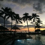 A view of the sunset from the pool