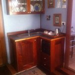 Kitchenette with fridge and microwave oven