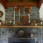 Fireplace in the dining area-seasonal decor.