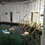 Changing rooms and flotation noodles on the perimiter of Men's Pool