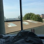 View laying in bed, a roof (This is the upgraded river view room!)
