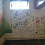 the graffiti done by prisoners in one of the cells as they were taught calligraphy