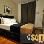 Select rooms have large queen sized beds in the separate bedrooms in deluxe suites