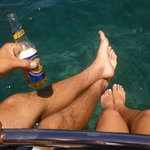 On the snorkelling tour, on the front of the boat, drink in hand