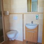 Our private bathroom! Very small but clean and modern.