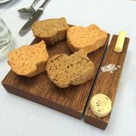 Homemade bread rolls with flavoured butter and sea salt
