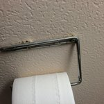 Toilet roll holder hanging off the wall