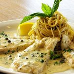 Chicken Piccata in a delicious piccata sauce with capers and a side of pasta