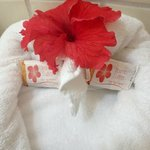 Hand towel design with hotel soap, and flower