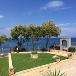 The gardens of the hotel overlooking the Ionian Sea with Kephalonia in the distance