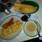 Chesse and tomato omelet, cuban toast and cafe con leche