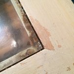 Table top with crumbs and gunk under where edge of glass sits. Housekeeping did come and scrub i
