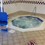 The indoor hot tub located in pool area.