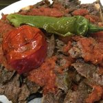 Iskender Kabob, which is a dish of Döner Kebab (marinated /seasoned lamb meat cooked on a rotiss