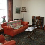 Living room,  lovely old books to check out.