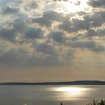 Sunrise with clouds - Mackinaw Island in background