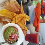 Root and plantain chips with guacamole at poolside restaurant