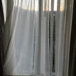 Ripped curtain in guest room