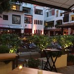 Court yard area, surrounded by Resturants and bars. With a relaxing seating area.