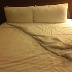 No comforter, no luxury pillows.  This is a sad sad bed and not Marriott style
