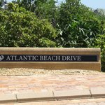 Self explanatory sign of Atlantic Beach Drive as the main rd in the Estate