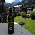 Relaxing on the hotel grounds with a nice bottle of local wine - and a view of the Matterhorn