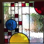 Gorgeous California Craftsman style stained glass on the garden cottage doors.
