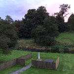 View from the bedroom over garden to hot tub, Gamekeepers cottage.