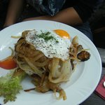 Schnitzel with egg and onion
