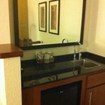 Wet bar with a refrigerator and sink