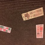 Floor littered with pizza menus