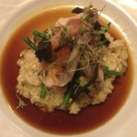 Chicken wrapped in pancetta on risotto