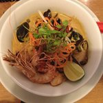 Spicy Laksa soup with king prawns, mussels, fish, lemongrass, coconut & egg noodles