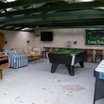 Games room with air hockey, pool table and table football