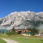 View of the hotel in front of the Dachstein peaks