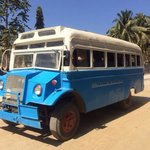 Thande hotel old bus heading to hotel from airport on dirt main road.