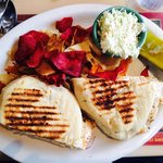 Chicken Fresco Caprese Panini with chips and pickle, slaw.