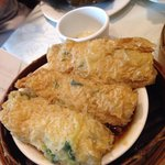 Fish cake wrapped with steamed bean curd skin in oyster sauce