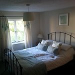 Room 1 - lovely comfy bed, lots of closet space and plenty of mirrors. TV and tea/coffee in room
