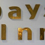 Crooked Days Inn logos above main reception desk