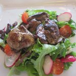 Chicken livers on a bed of salad