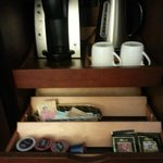 Keurig coffee maker, some k-cups, kettle and free in-room safe.